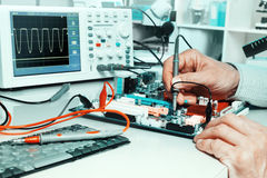 Tech tests electronic equipment Stock Image