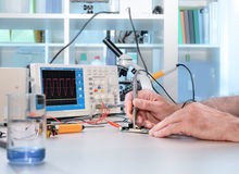 Tech tests electronic equipment Stock Photos