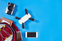Tech travel gadgets and toys in travel backpack Stock Photography