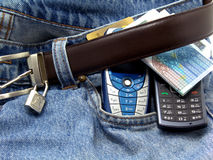 Banknotes and mobile phones on denim pants Royalty Free Stock Photography