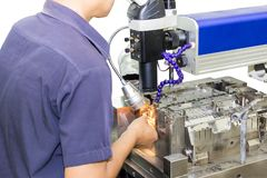Techncian during repair metal mold and die part by laser welding method on wihte background stock photography