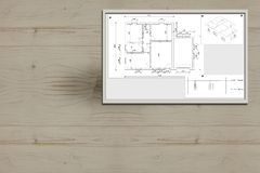 House project in the wall. Technic construction architectural framed project, printed on the paper and posted on a wooden wall Royalty Free Stock Image
