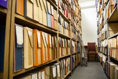 Technical archive room with a lot of cardboard boxes full of detailed drawings Royalty Free Stock Image