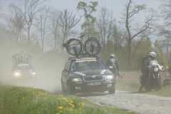 Technical Cars on Paris-Roubaix. Carrefour de l Arbre,France-April 13,2014: Row of technical vehicles transportin bicycles on the famous dusty cobblestone sector Royalty Free Stock Photos