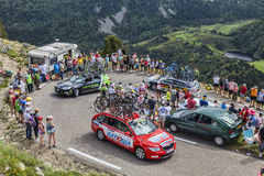 Technical cars in Pyrenees Mountains. Col de Pailheres,France- July 06 2013: Row of technical cars of various procycling teams climbing the road to Col de Stock Photos