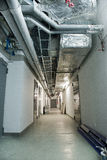 Technical corridor. Lots of pipes, electric cables Royalty Free Stock Photography