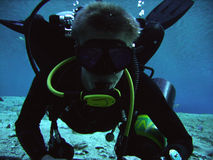 Technical Diver. Close-up of a technical cave diver doing a mandatory decompression stop Royalty Free Stock Images