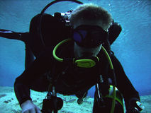 Technical Diver. Close-up of a technical cave diver doing a mandatory decompression stop Stock Image