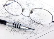 Technical drawing with glasses and pencil. A technical drawing with glasses and pencil royalty free stock image