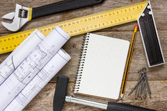 Technical drawing and tools with blank notebook Royalty Free Stock Images