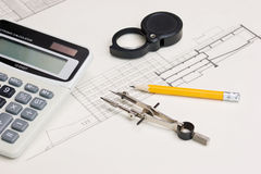 Technical drawings and  calculator Royalty Free Stock Photos