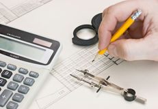 Technical drawings and hand with  pencil Royalty Free Stock Photos