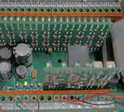 Technical electrical circuits Boards. Printed Circuit Board with many electrical components royalty free stock photo