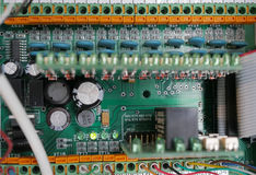 Technical electrical circuits Boards. Printed Circuit Board with many electrical components royalty free stock images