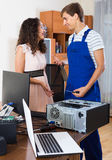 Technical engineer upgrading hardware of client computer Royalty Free Stock Images