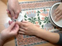Technical execution of classical manicure. On foot Royalty Free Stock Images