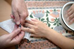 Technical execution of classical manicure Stock Photos