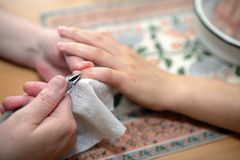 Technical execution of classical manicure. On foot Stock Photos