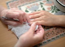 Technical execution of classical manicure Royalty Free Stock Photography