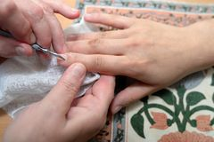 Technical execution of classical manicure. On foot Royalty Free Stock Image