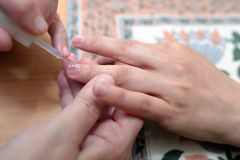 Technical execution of classical manicure. On foot Royalty Free Stock Photography