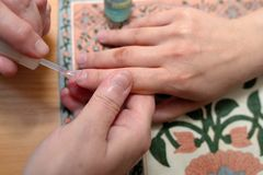 Technical execution of classical manicure Royalty Free Stock Photos