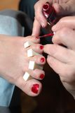 Technical execution of classical pedicure Royalty Free Stock Photography
