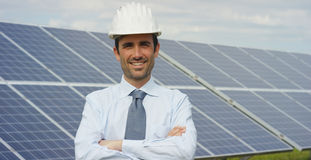 Technical expert in solar energy photovoltaic panels, remote control performs routine actions for system monitoring using clean, r. Enewable energy. concept of Stock Photo