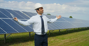 Technical expert in solar energy photovoltaic panels, remote control performs routine actions for system monitoring using clean, r. Enewable energy. concept of Stock Image