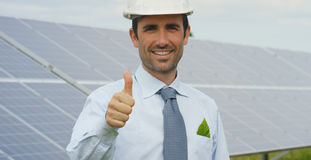 Technical expert in solar energy photovoltaic panels, remote control performs routine actions for system monitoring using clean, r. Enewable energy. concept of Royalty Free Stock Image
