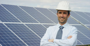 Technical expert in solar energy photovoltaic panels, remote control performs routine actions for system monitoring using clean, r. Enewable energy. concept of Royalty Free Stock Photos