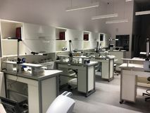 Technical laboratory with tables workplaces. White technical laboratory with tables and lamps workplaces Royalty Free Stock Photos