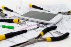 Technical operator and repair smartphone Stock Images