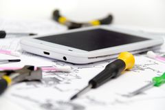 Technical operator and repair smartphone Royalty Free Stock Photo