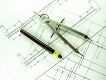 Technical Pen & Compass. Technical drawing pen and compass over beam and joist designs Royalty Free Stock Photo
