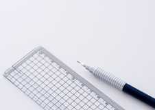 Technical pencil and ruler. Plastic ruler and technical pencil for drawing stock photography