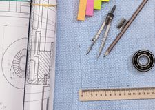 Technical project drawing above graph paper with engineering tools. Construction background royalty free stock image