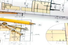 Technical project drawings, rolls of blueprints and drawing tool. Rolls of blueprints with architectural plans and technical drawings closeup stock image