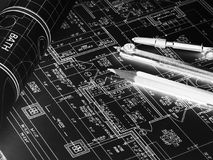 Technical project drawings, rolls of blueprints and drawing tool. S. Architectural project royalty free stock image