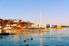 Technical quay port with high white cranes Stock Photos