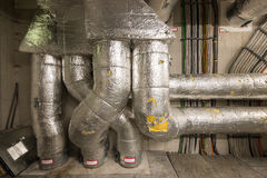 Technical room with insulated pipes Stock Images