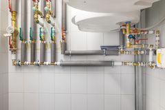 white boiler for water heating and  piping system with grey pipe Royalty Free Stock Photos