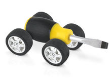 Technical service concept. Screw-driver on car wheels Royalty Free Stock Images