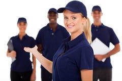 Technical service worker. Pretty female technical service worker presenting team on white Stock Image