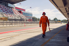 Technical staff male in an orange jumpsuit , the clothes are on the inner track Stock Photos