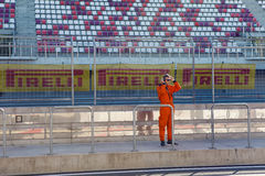 Technical staff male in an orange jumpsuit , the clothes are on the inner track Royalty Free Stock Image