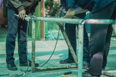 Technical students are helping to make a small soccer goal. Technical students are helping to make a small soccer goal in school Stock Photography