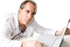 Technical support. Doctor with stethoscope fixing laptop, good technical support symbol Royalty Free Stock Photo