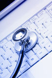 Technical support. Computer keyboard with stethoscope. Good technical support symbol Royalty Free Stock Images