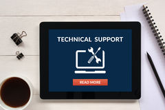 Technical support concept on tablet screen with office objects. On white wooden table. All screen content is designed by me. Flat lay Stock Photo